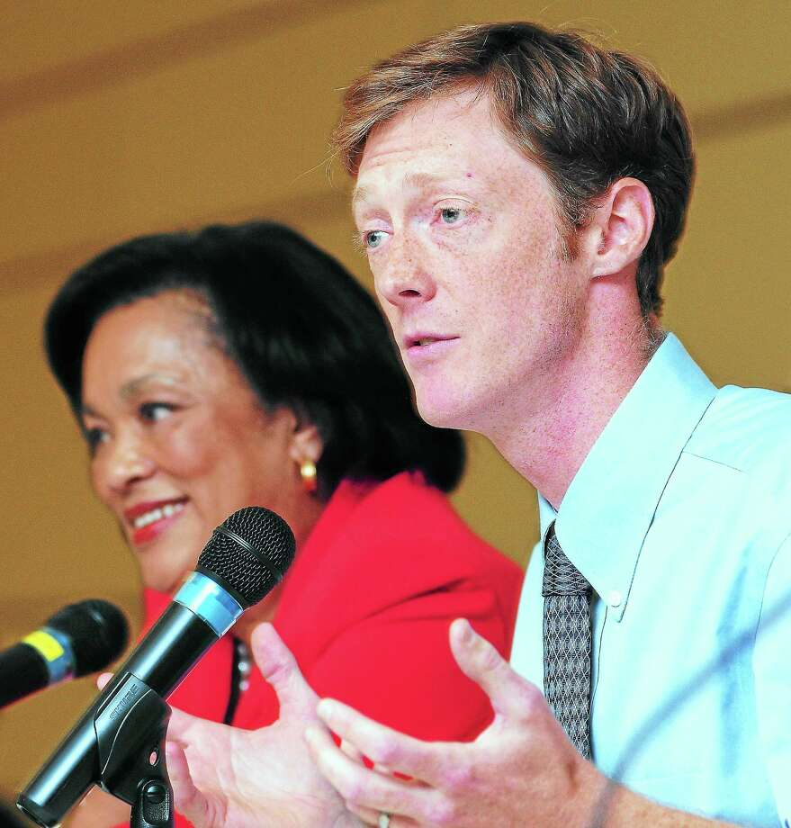 (Arnold Gold — New Haven Register)  New Haven mayoral candidate Justin Elicker (right) answers a question during a debate with Toni Harp (left) at Gateway Community College in New Haven on 10/22/2013. Photo: Journal Register Co.