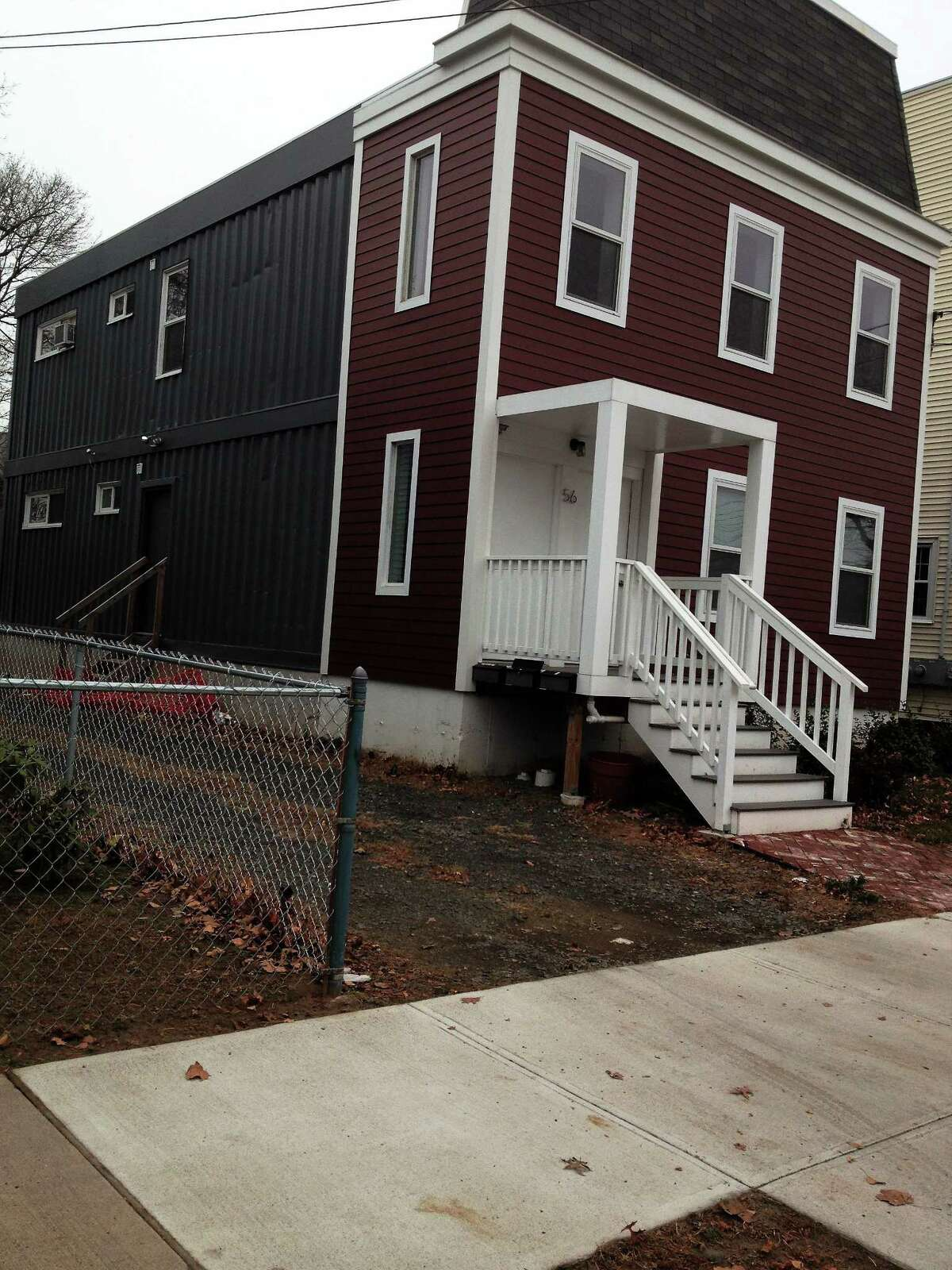 Christian Salvati's container house at 56 Vernon St. New haven An apartment complex is under constructi?on on Ella Grasso Boulevard