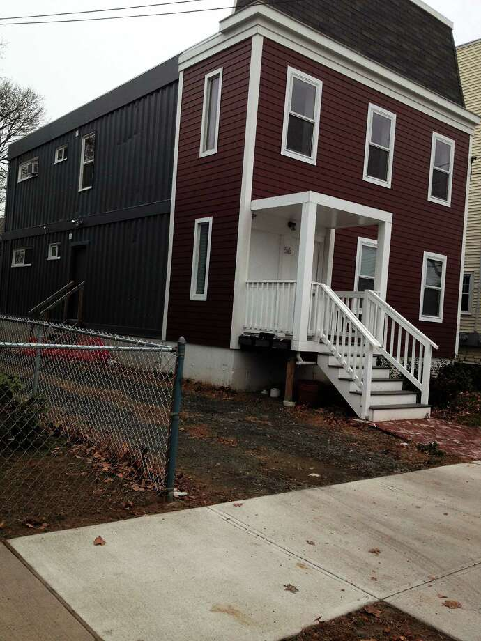 Christian Salvati's container house at 56 Vernon St. New haven An apartment complex is under constructi?on on Ella Grasso Boulevard Photo: Journal Register Co.