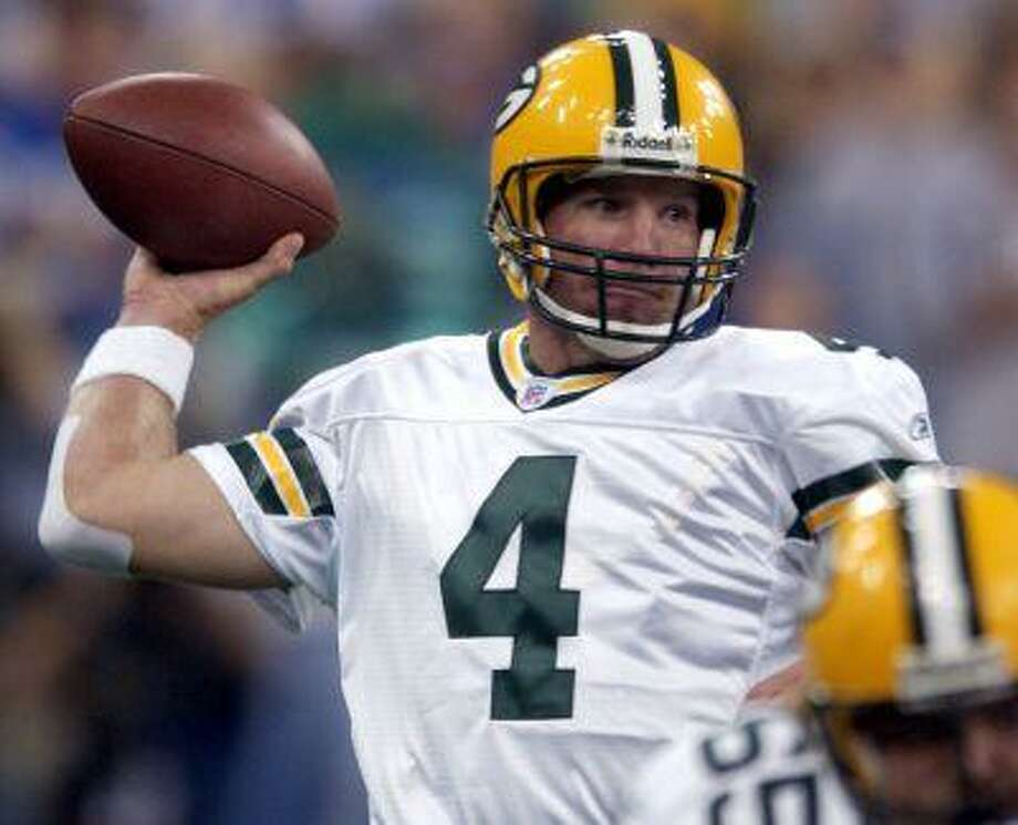 Green Bay Packers quarterback Brett Favre throws a pass against the Indianapolis Colts in the first quarter of a 2004 game. Photo: AP / 2004 AP