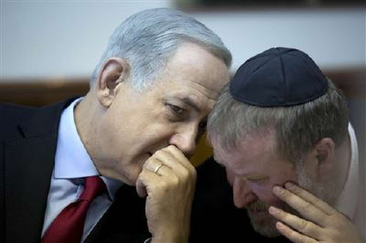 Israeli Prime Minister Benjamin Netanyahu, left, attends the weekly cabinet meeting at his Jerusalem office on Sunday.