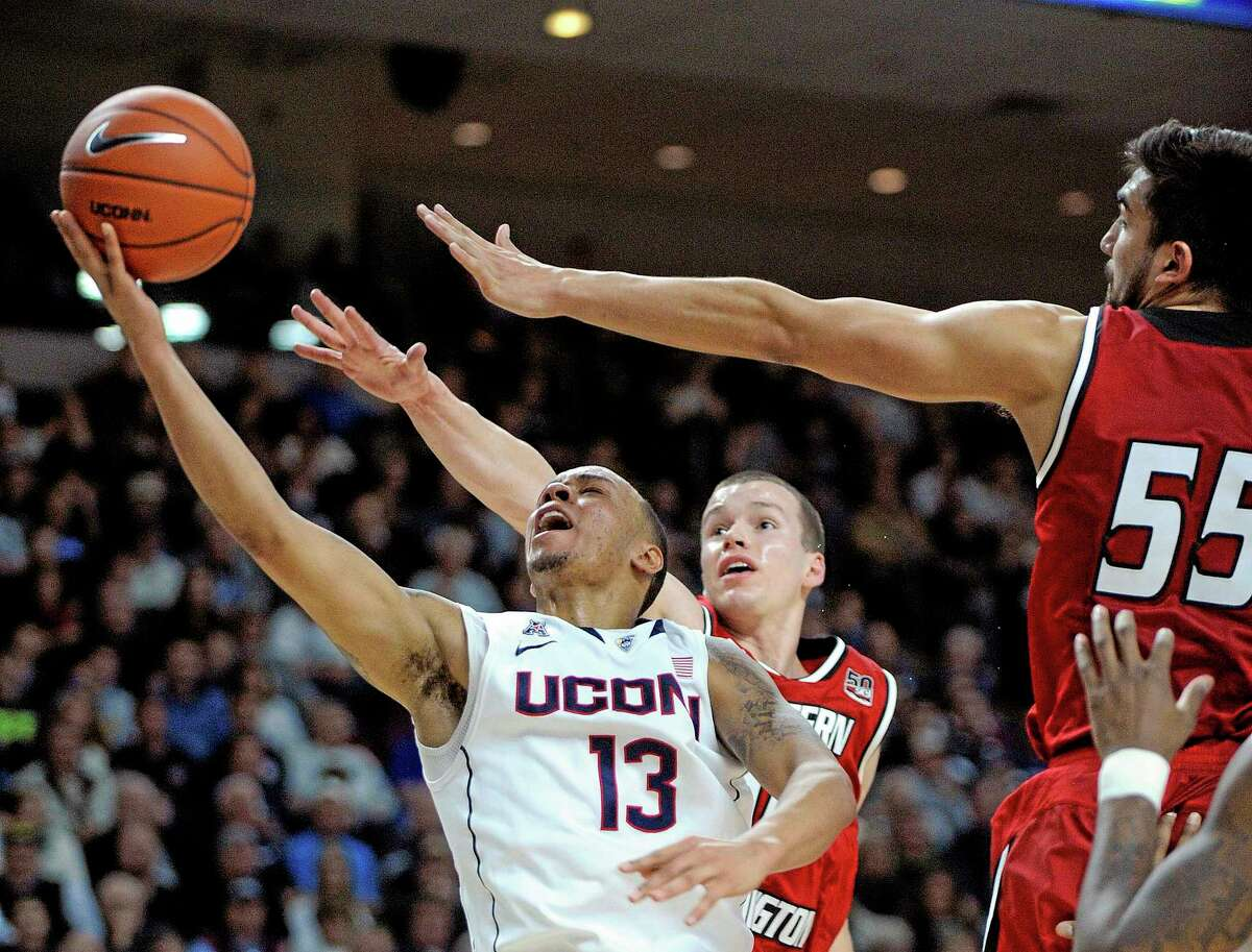 UConn's Shabazz Napier (13) drives past Eastern Washington's Parker Kelly (10) and Venky Jois (55) during the second half of Saturday's game in Bridgeport.
