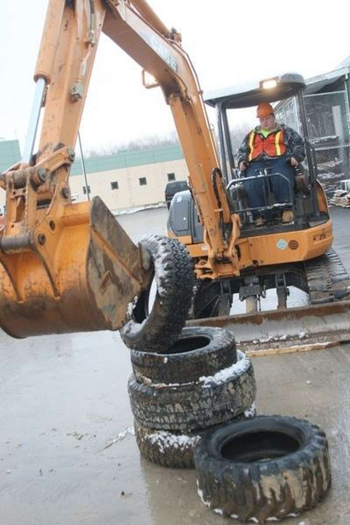 John Haeger @OneidaPhoto on Twitter/Oneida Daily Dispatch Alexander Kirt of Camden shows his heavy equipment operating skills as he stacks tires during the Madison-Oneida BOCES open house in Verona on Wednesday, March 13, 2013
