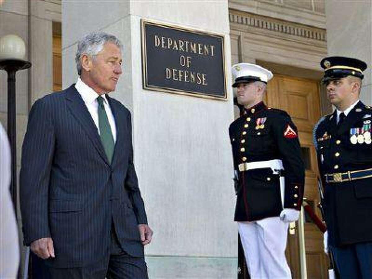 Secretary of Defense Chuck Hagel on the steps of the Pentagon in Washington, Thursday, May 2, 2013. (AP Photo/J. Scott Applewhite)