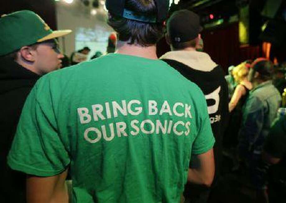 """A fan wears a shirt that reads """"Bring Back Our Sonics,"""" as he attends a rally May 13, 2013, in Seattle. Photo: AP / AP"""