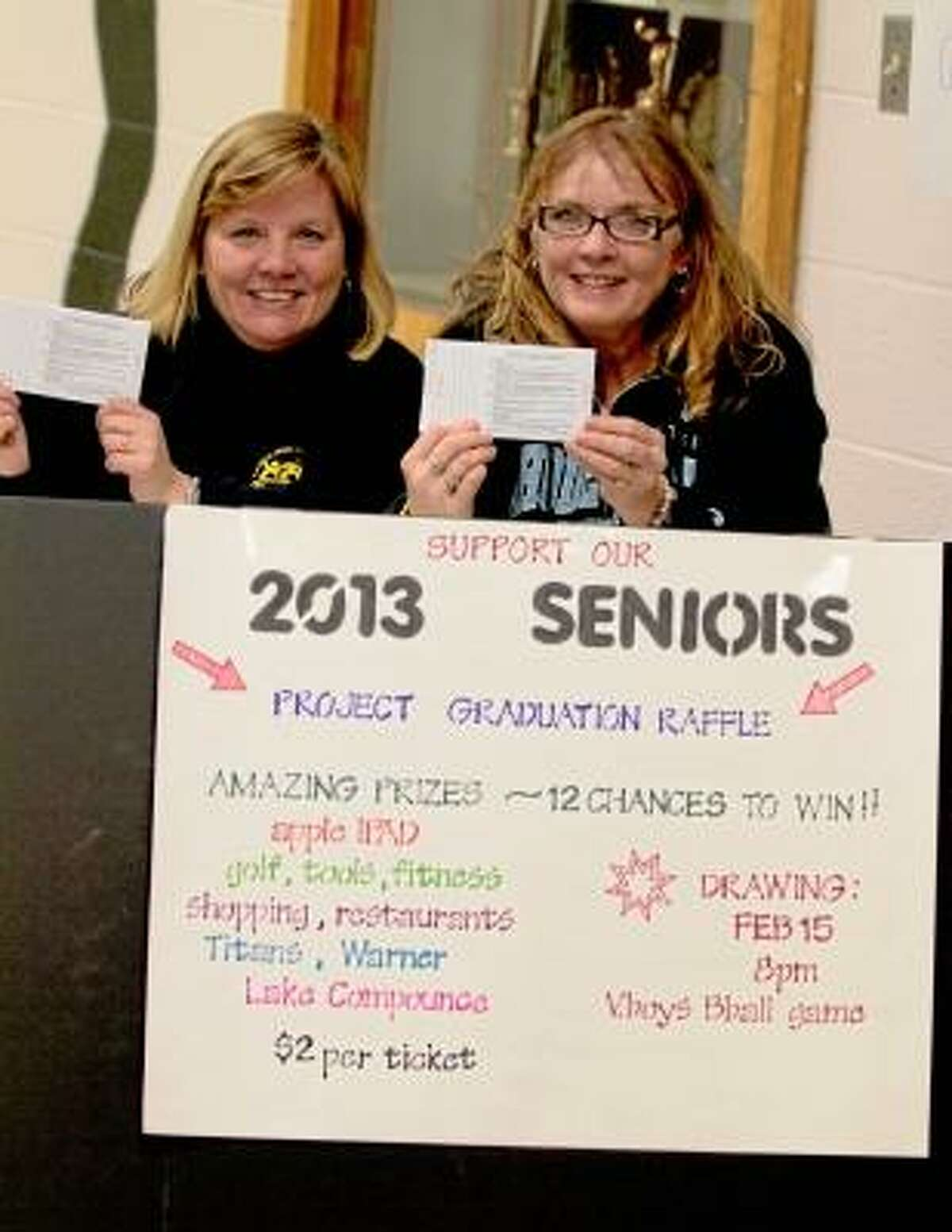 Photo by Marianne Killackey Angela Thompson and Kathi Peterson sold raffle tickets to benefit this year's Torrington High School Project Graduation at the girls' basketball game Friday night. Project Graduation is an all night, drug and alcohol free party that is designed to keep THS seniors safe on their graduation night. Ticket prizes this year include an iPad, a round of golf, a couples weekend away including hotel, Tickets to the Warner Theater and gift card to Backstage, $100 gift card to JC Pennys, gift card to Lowes and more. If interested in purchasing tickets, contact Kathi Peterson 860 482 6636 or Cathy Reynolds 860 480 4807.