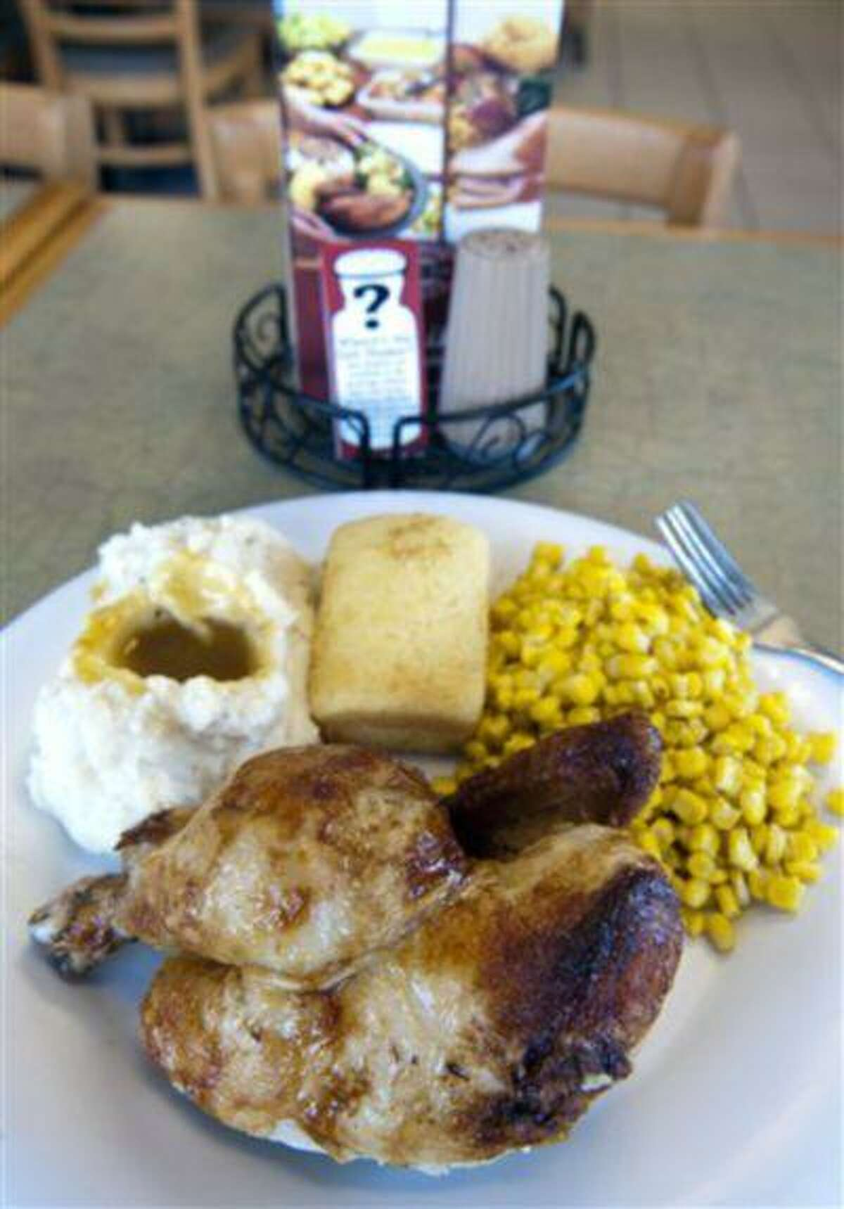 A half-chicken lunch sits on a table of the Alexandria, Va., Boston Market restaurant Tuesday, May 14, 2013. Boston Market has removed salt shakers from the table and placed them with other condiments on the beverage dispenser table. A surprising new report questions how sharply Americans should cut back on salt. Make no mistake: Most Americans eat way too much, not just from salt shakers but because of sodium in processed foods. The Institute of Medicine said Tuesday there's no evidence that cutting well below established guidelines offers any benefit -- even though that's recommended for certain people at high risk of heart disease. There are some suggestions that going way too low might harm certain patients.