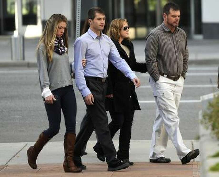 Ryan and Eric Jensen pleaded guilty in the fatal, 2011 cantaloupe listeria outbreak in federal court in Denver on Tuesday, Oct. 22, 2013. Photo: DP / Copyright - 2013 The Denver Post, MediaNews Group.