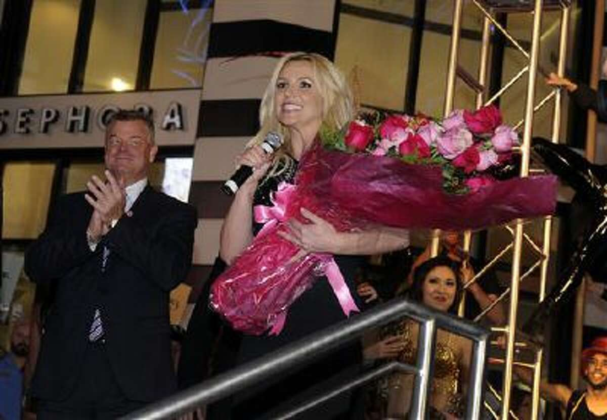"""Singer Britney Spears speaks to the crowd after arriving at Planet Hollywood Resort & Casino before the debut of her two-year Las Vegas residency """"Britney: Piece of Me"""" on Tuesday, Dec. 3, 2013, in Las Vegas."""