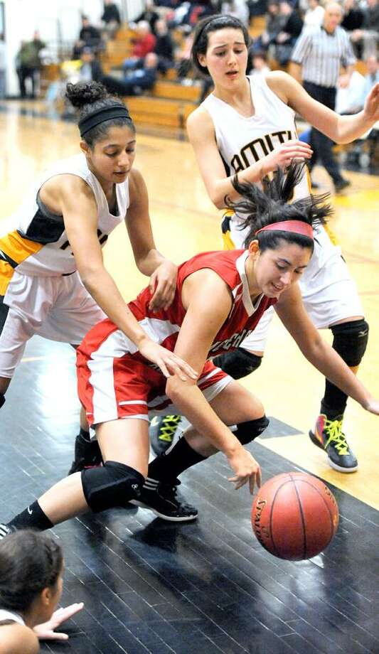 A pair of Amity defenders close in on Sacred Heart's Micaela Montini during a recent game. (Arnold Gold/Register file photo)