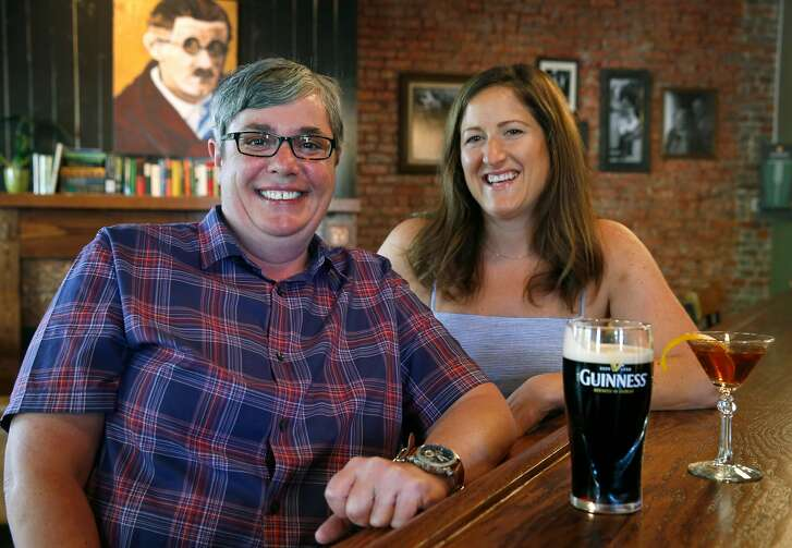 Co-owners Jackie Gallanagh (left) and Jenny Schwarz sit at the bar of Sl�inte, a new Irish pub in Oakland, Calif. on Saturday, July 22, 2017.