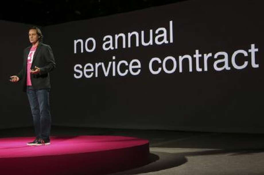 T-Mobile CEO John Legere speaks during a news conference Tuesday, March 26, 2013 in New York.