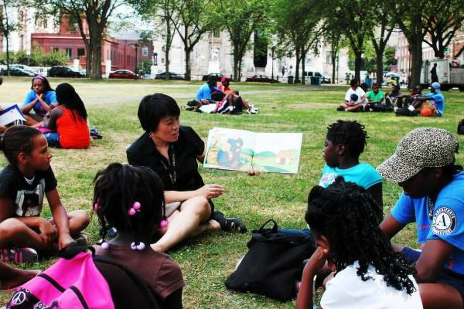 Contributed photo: Xia Cheng of the New Haven Free Public Library reads at a previous event.
