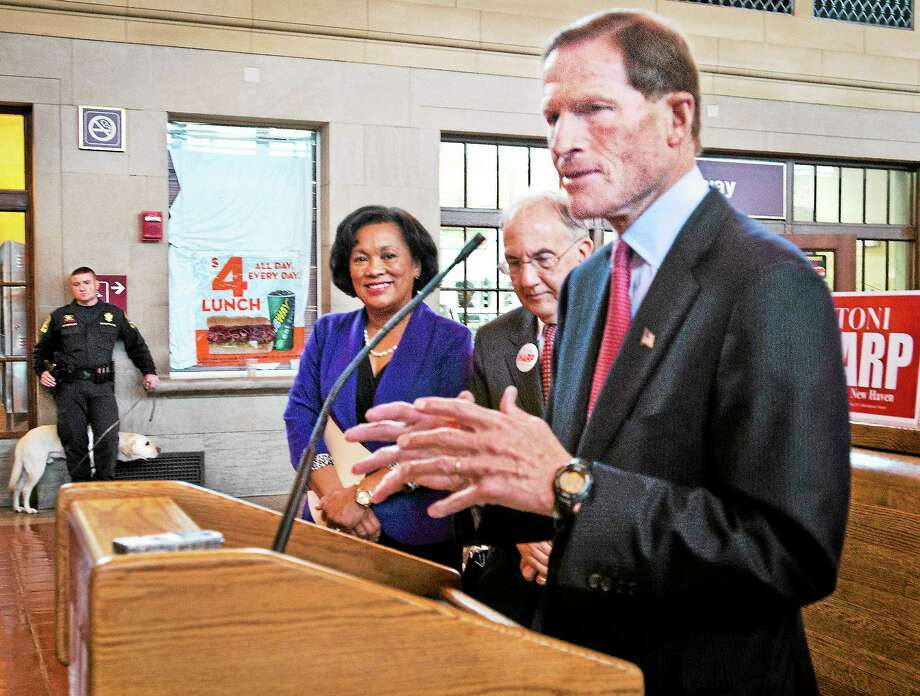 From left, New Haven mayoral candidate state Sen., Toni Harp, state Sen. Martin M. Looney, D-New Haven, and U.S. Sen Richard Blumenthal, D-Conn., speak about plans for improving train service to New York City. Photo: Melanie Stengel — New Haven Register