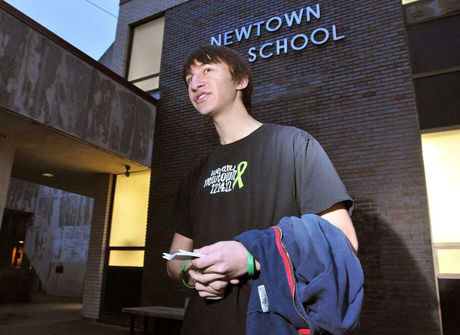 Newtown-- Mergim Bajraliu, a Newtown High School senior talks to the media outside the high school after a community meeting to discus the fate of the Sandy Hook Elementary School. Bajraliu's sister, a 4th grader at Sandy Hook, was there the day of the shootings. Bajraliu believes the elementary school should be kept standing. Photo-Peter Casolino 1/13/13