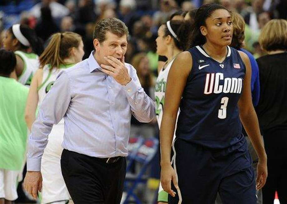 Connecticut head coach Geno Auriemma left, walks off the court with Connecticut's Morgan Tuck after their 61-59 loss to Notre Dame in an NCAA college basketball game in the final of the Big East Conference women's tournament in Hartford, Conn., Tuesday, March 12, 2013. (AP Photo/Jessica Hill) Photo: ASSOCIATED PRESS / A2013