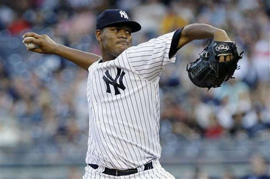 New York Yankees' Ivan Nova delivers a pitch during the first inning of a baseball game against the Baltimore Orioles, Friday, July 5, 2013, in New York. (AP Photo/Frank Franklin II) Photo: AP / AP