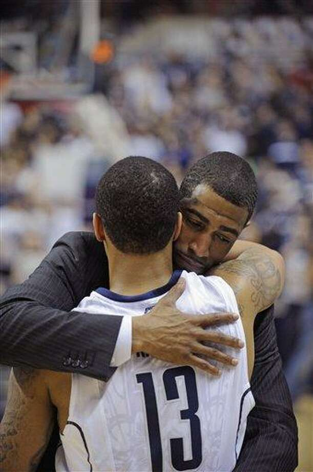 Connecticut coach Kevin Ollie hugs Shabazz Napier after his team's 63-59 overtime win against Providence in an NCAA college basketball game in Storrs, Conn., Saturday, March 9, 2013. (AP Photo/Fred Beckham) Photo: ASSOCIATED PRESS / AP2013