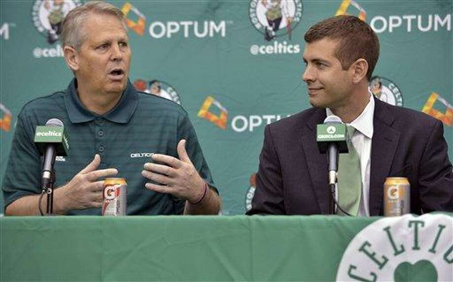 Boston Celtics general manager Danny Ainge, left, speaks alongside new head coach Brad Stevens, right, during a news conference where Stevens was introduced Friday, July 5, 2013, at the NBA basketball team's training facility in Waltham, Mass. Stevens twice led the Butler Bulldogs to the NCAA title game. He replaces Doc Rivers, who was traded to the Los Angeles Clippers. (AP Photo/Josh Reynolds) Photo: AP / FR25426 AP