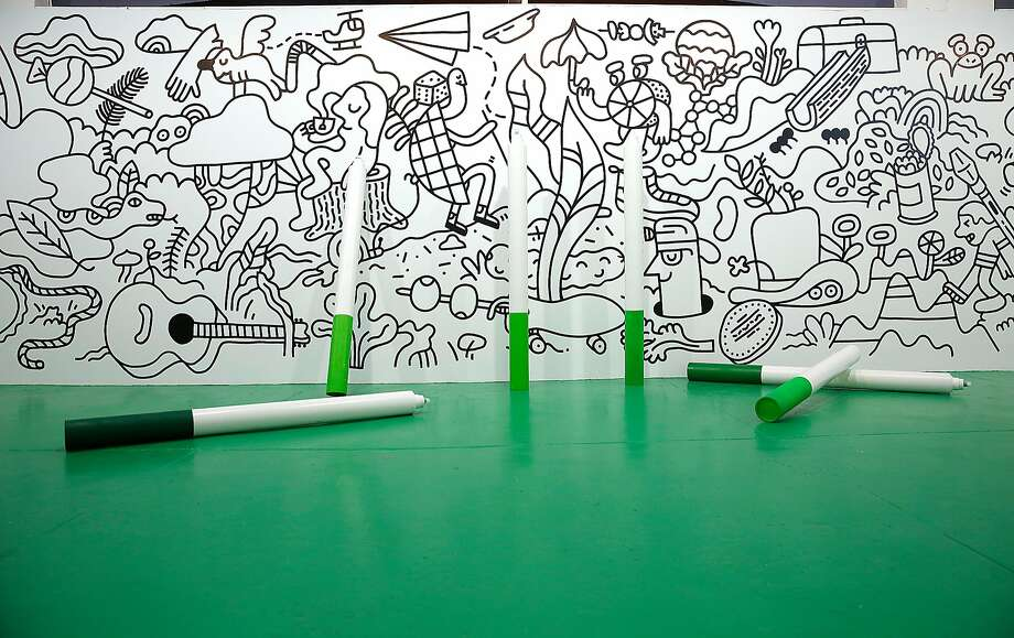 Artists Andy j. Miller and Andrew Neyer collaborated on this large-scale black and white mural and made these large coloring pens to leave the coloring up to visitors. Photo: Liz Hafalia, The Chronicle