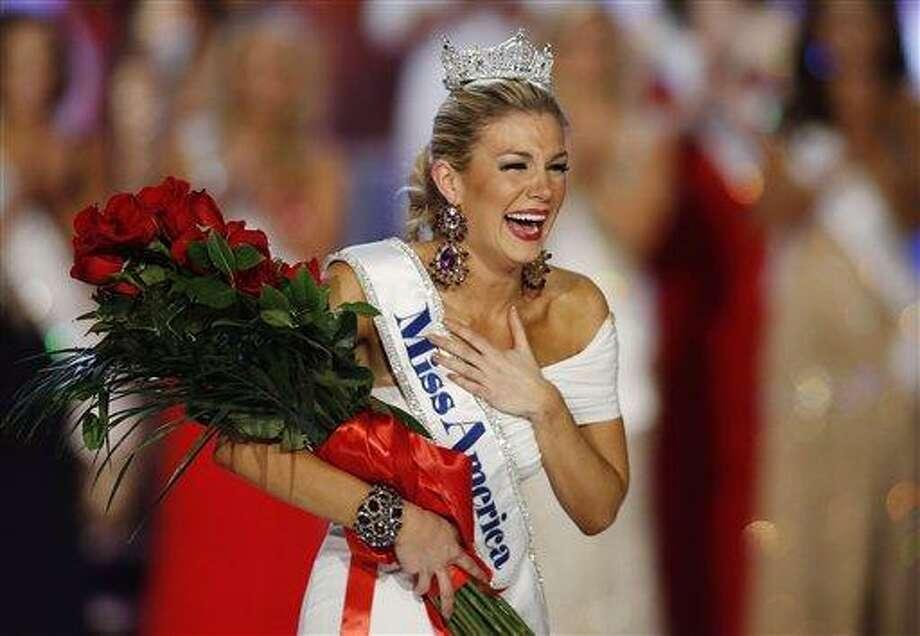 Miss New York Mallory Hytes Hagan reacts as she is crowned Miss America 2013 on Saturdayin Las Vegas. AP Photo/Isaac Brekken Photo: AP / FR159466 AP