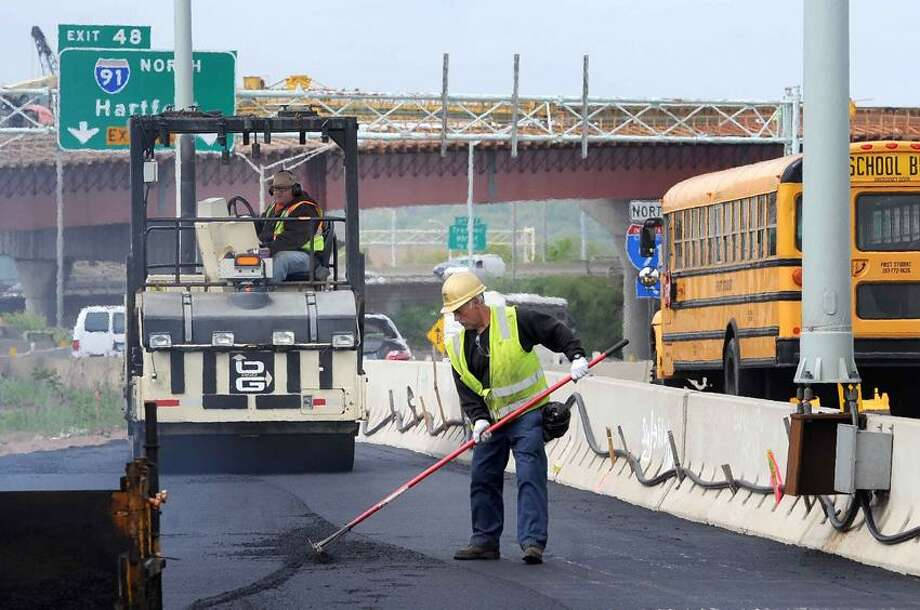 Crews asphalt new roadway that will become the new I91 ramp from I95 May 15, 2013. vmWilliams