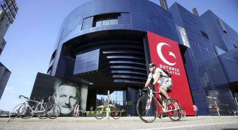 A biker pedals past the Guthrie Theater in the heart of the old milling district in Minneapolis, Minnesota July 2, 2013. REUTERS/Eric Miller (UNITED STATES - Tags: CITYSPACE TRAVEL) Photo: REUTERS / X00191
