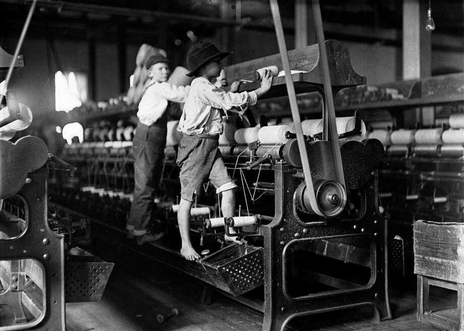 Children doing difficult jobs, such as those at this mill, led to calls for reform in the 20th century. Social reformers have long used photographs like this as evidence to ban child labor, reduce the hours that women could work and expose unsanitary workplaces. Photo: Courtesy National Archives And Records Administration