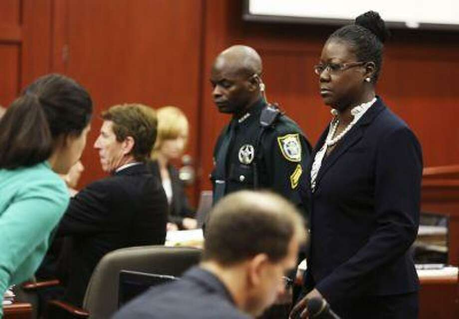 Sybrina Fulton, Trayvon Martin's mother, walks past the defense table after taking the stand during George Zimmerman's trial in Seminole circuit court in Sanford, Florida July 5, 2013. (Gary W. Green/Reuters/Pool) Photo: REUTERS / X80003