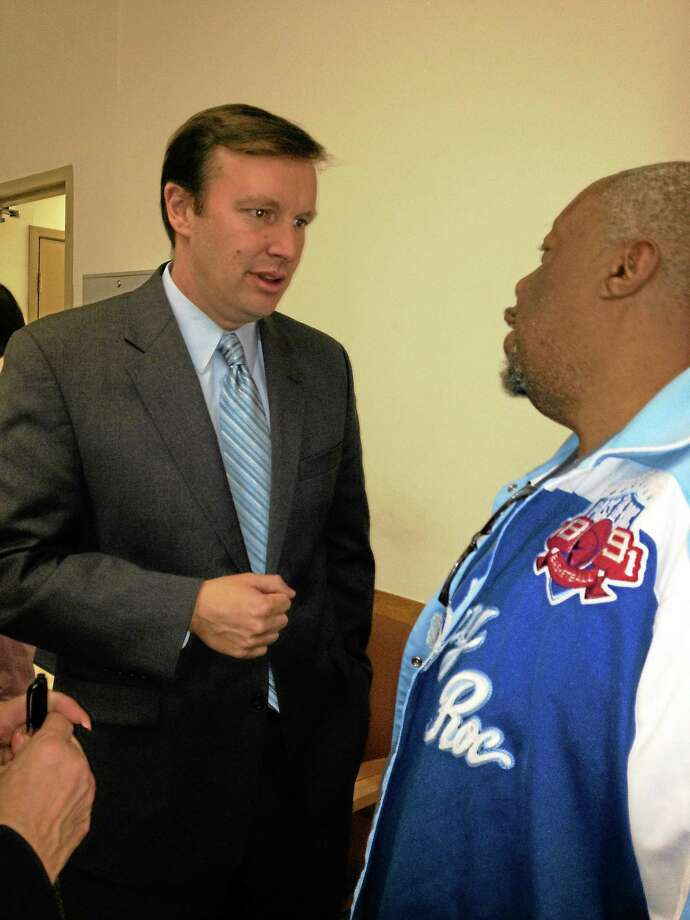 U.S. Sen. Chris Murphy talks to patient Willie Hill at Cornell Scott Healthcare Clinic in New Haven Photo: Journal Register Co.