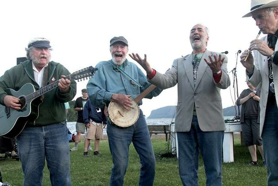 Folk singer Pete Seeger is shown leading a sing along on the banks of the Hudson River in Croton Point Park in Croton-on-Hudson, New York. Photo: Photo By John Atashian / John Atashian