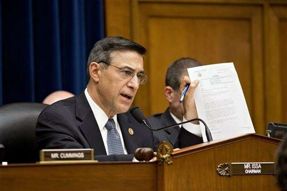 House Oversight Committee Chairman Rep. Darrell Issa, R-Calif., displays a letter of praise from President Obama to Gregory Hicks, former deputy chief of mission in Libya, number two in rank to slain U.S. Ambassador Christopher Stevens, during a House Oversight Committee hearing about last year's deadly assault on the U.S. diplomatic mission in Benghazi, Libya, on Capitol Hill in Washington, Wednesday, May 8, 2013. House Republicans insist the Obama administration is covering up information about the attack, rejecting administration assurances to the contrary and stoking a controversy with implications for the 2016 presidential race.  (AP Photo/J. Scott Applewhite) Photo: AP / AP