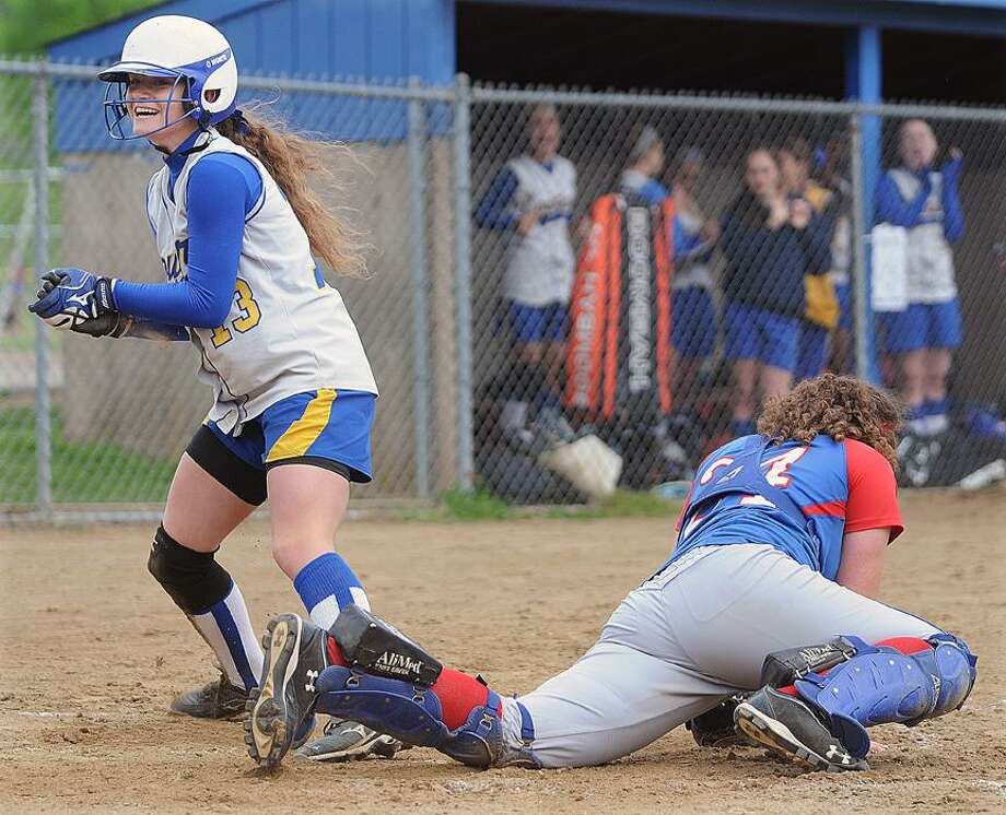 Catherine Avalone/The Middletown PressHaddam-Killingworth senior Sam Waskowitz slides in safely at home to complete her inside-the-park grand slam in the second inning, sneaking by the tag of Coginchaug catcher Jackie Benson Wednesday in Durham. H-K won, 6-3. / TheMiddletownPress