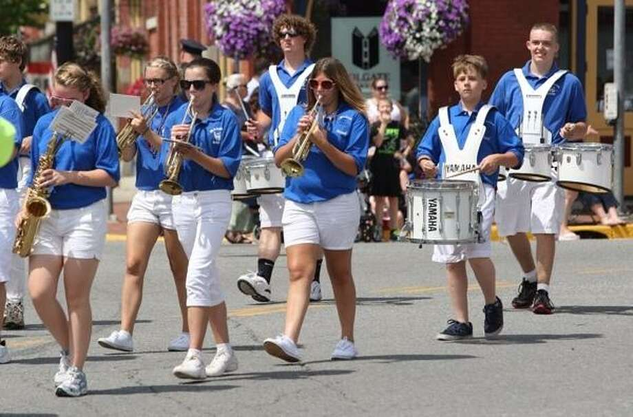 Members of Madison High School marching band make their way along the parade route in Hamilton on Thursday, July 4, 2013. JOHN HAEGER @ONEIDAPHOTO ON TWITTER/ONEIDA DAILY DISPATCH
