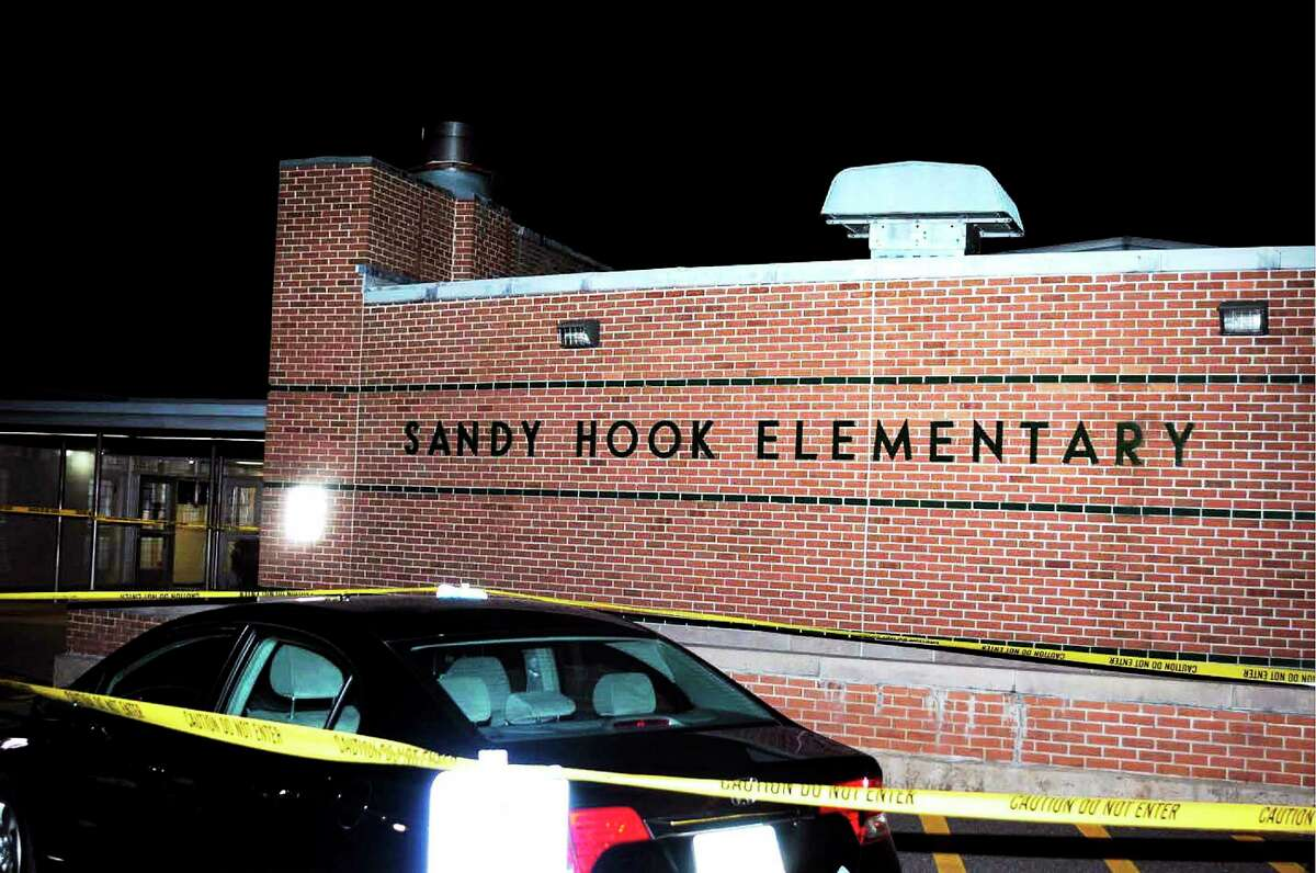 The car driven by Adam Lanza outside the front entrance to Sandy Hook Elementary School, in this photo supplied by the Connecticut State Police.
