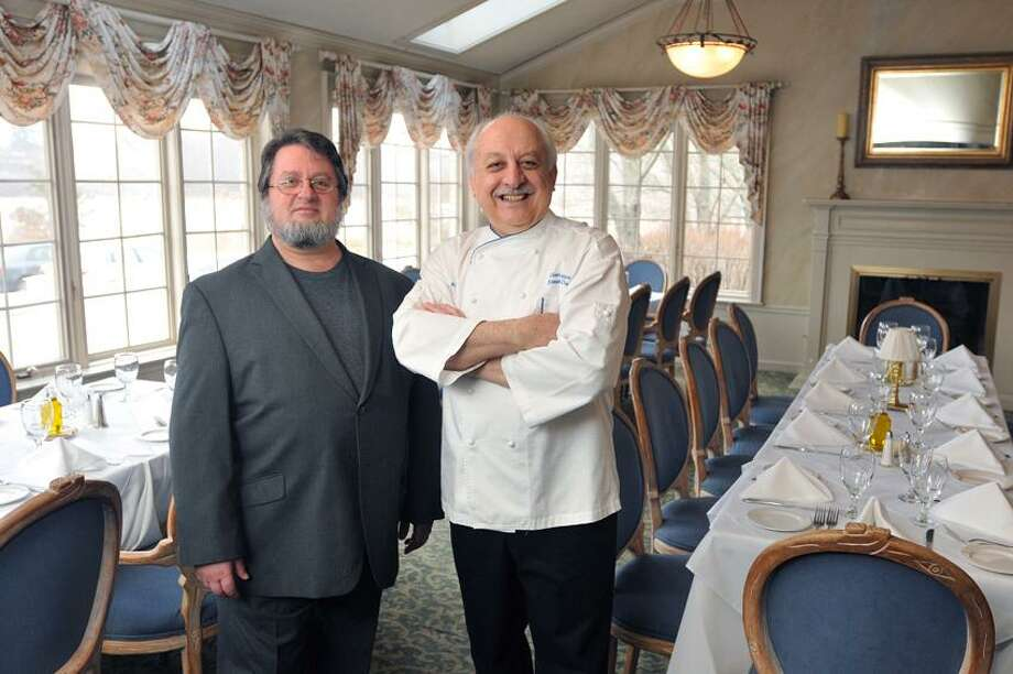 Peter Casolino/Register photo: Opera Theater of Connecticut Artistic Director Alan Mann, left, and Chef Silvio Suppa are cooking up an opera evening Jan. 20 at Cafe Allegre in Madison.