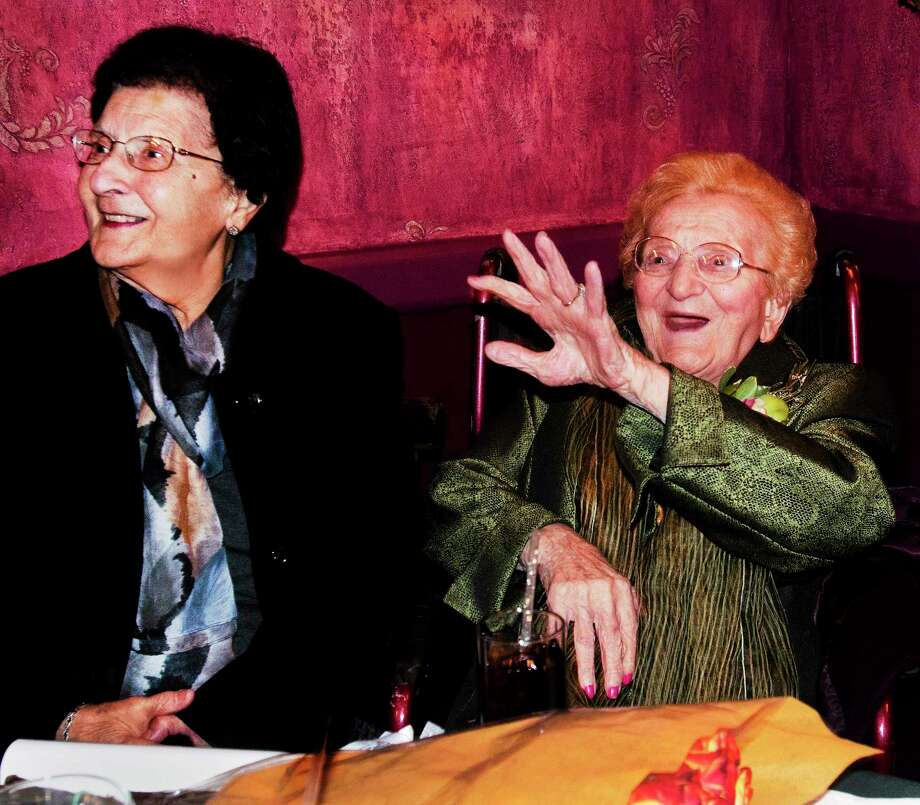 (Melanie Stengel — New Haven Register)  Theresa Argenta (L) sits with friend, Luisa DeLauro , as DeLauro greets guests at her 100th birthday party 12/27. The eventr was held  at Consiglio's Restaurant in New Haven. Photo: Journal Register Co.