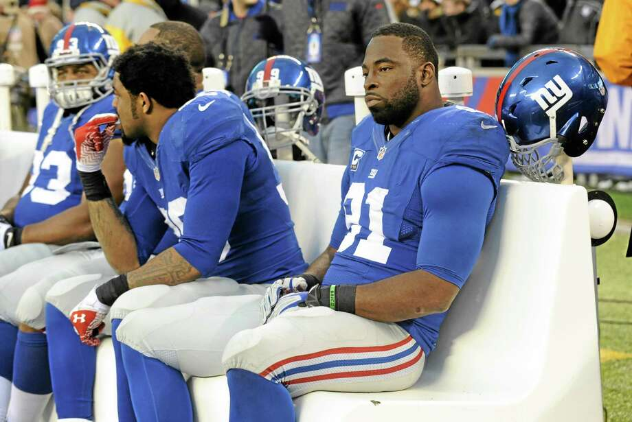 Sunday's game against the Washington Redskins might be Justin Tuck's last as a New York Giant. Photo: Bill Kostroun — The Associated Press   / FR51951 AP