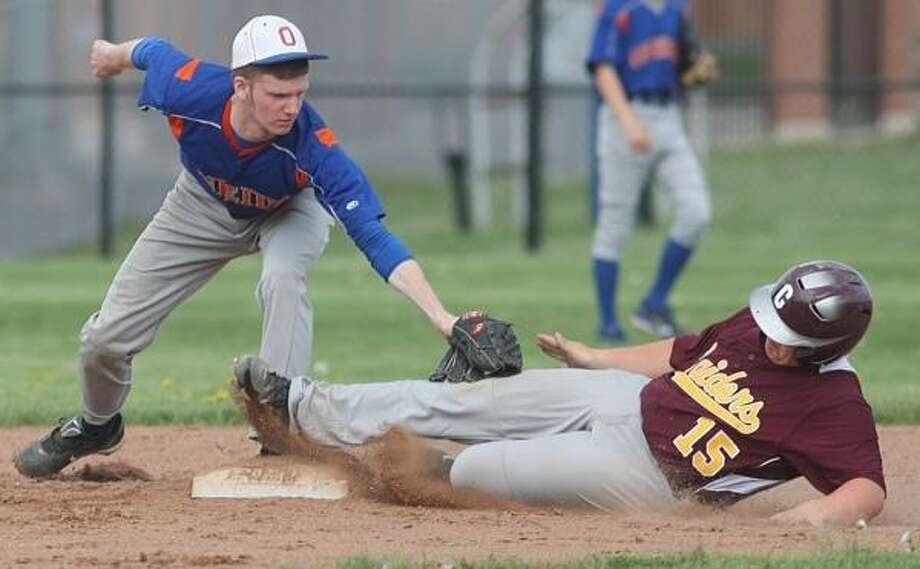PHOTO BY JOHN HAEGER @ ONEIDAPHOTO ON TWITTER/ONEIDA DAILY DISPATCH Oneida's Tyler Colvin (2) tags out Canastota's Tyler Doane (15) at second as he tries for the extra base in the top of the second inning of play in Oneida on Wednesday, May 15, 2013.