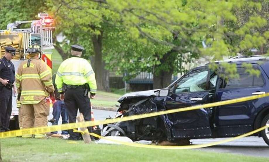 PHOTO BY JOHN HAEGER @ ONEIDAPHOTO ON TWITTER/ONEIDA DAILY DISPATCH Crews clean up following a two car motor vehicle accident on Lenox Ave. near the intersection of Cedar Street in the city of Oneida on Wednesday, May 15, 2013.