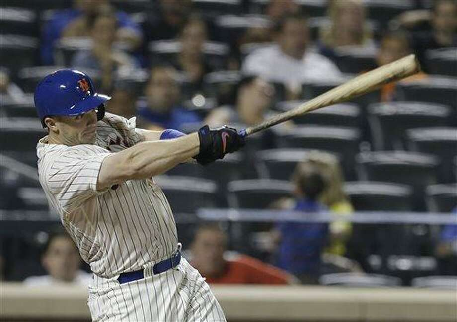 New York Mets' David Wright (5) follows through on a ground-rule double during the eighth inning of a baseball game against the Arizona Diamondbacks Wednesday, July 3, 2013, in New  York. (AP Photo/Frank Franklin II) Photo: AP / AP