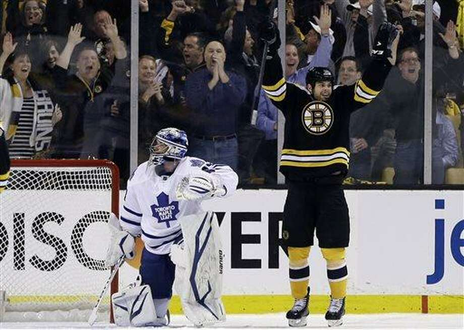 Boston Bruins right wing Nathan Horton, right, celebrates his goal against Toronto Maple Leafs goalie James Reimer (34) in the first period in Game 1 of a first-round NHL hockey playoff series in Boston, Wednesday, May 1, 2013. (AP Photo/Elise Amendola) Photo: AP / AP