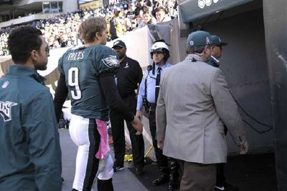 Philadelphia Eagles quarterback Nick Foles leaves the game against the Cowboys on Sunday after suffering a concussion. Photo: AP / FR168006 AP
