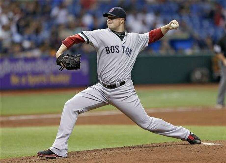 Boston Red Sox starting pitcher Jon Lester delivers to the Tampa Bay Rays during the third inning of a baseball game Wednesday, May 15, 2013, in St. Petersburg, Fla. (AP Photo/Chris O'Meara) Photo: AP / AP