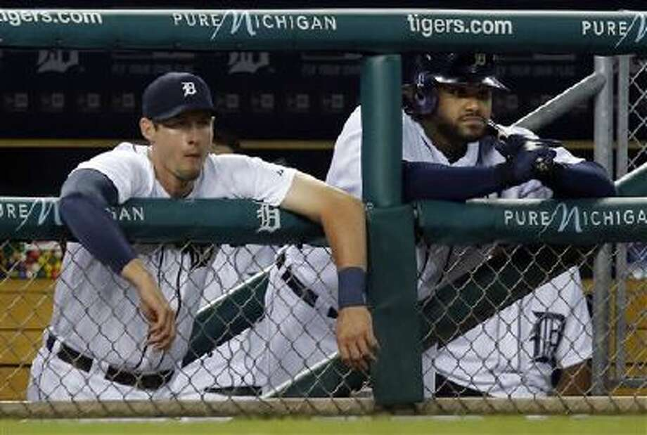 Detroit Tigers' Don Kelly, left, and Prince Fielder watch from the dugout during the ninth inning of a 10-6 loss to the Boston Red Sox in a baseball game on Friday, June 21, 2013 in Detroit. (AP Photo/Duane Burleson) Photo: AP / FR38952 AP