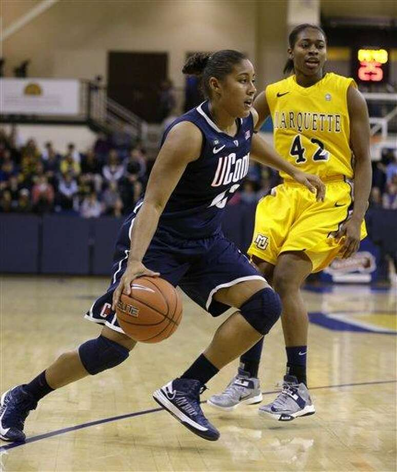 Connecticut's Kaleena Mosqueda-Lewis drives against Marquette's Sarina Simmons during the second half of an NCAA college basketball game Saturday, Jan. 12, 2013, in Milwaukee. (AP Photo/Jeffrey Phelps) Photo: ASSOCIATED PRESS / AP2013