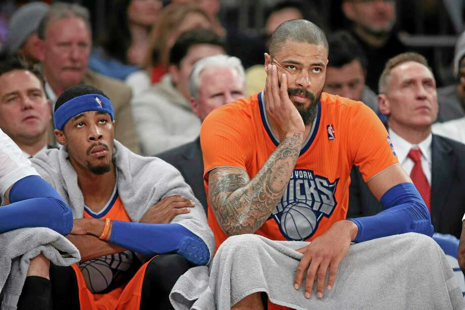 Knicks center Tyson Chandler, right, and guard Toure' Murry watch during the second half of the Knicks' loss to the Thunder on Wednesday in New York. The Thunder won 123-94. Photo: John Minchillo — The Associated Press   / FR170537 AP