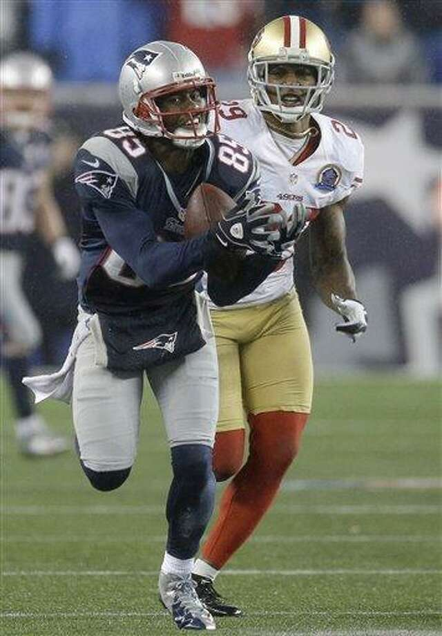 New England Patriots wide receiver Brandon Lloyd (85) catches a pass in front of San Francisco 49ers defensive back Chris Culliver (29) in the fourth quarter an NFL football game in Foxborough, Mass., Sunday, Dec. 16, 2012. (AP Photo/Elise Amendola) Photo: ASSOCIATED PRESS / AP2012