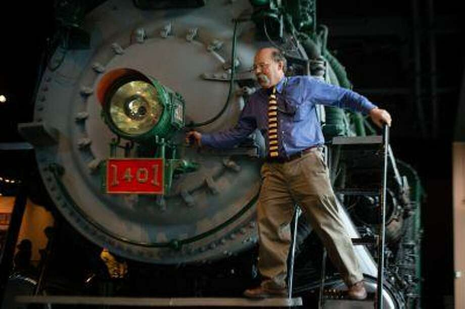 Peter Liebhold, who oversees the National Museum of American History's transportation exhibition, stands on a locomotive featured in it. Ten years later, the collection remains one of the most popular stops at the museum. Illustrates MUSEUM-TRANSPORT (category l), by Mark Berman (c) 2013, The Washington Post. Moved Monday, May 13, 2013. (MUST CREDIT: Washington Post photo by Sarah L. Voisin)