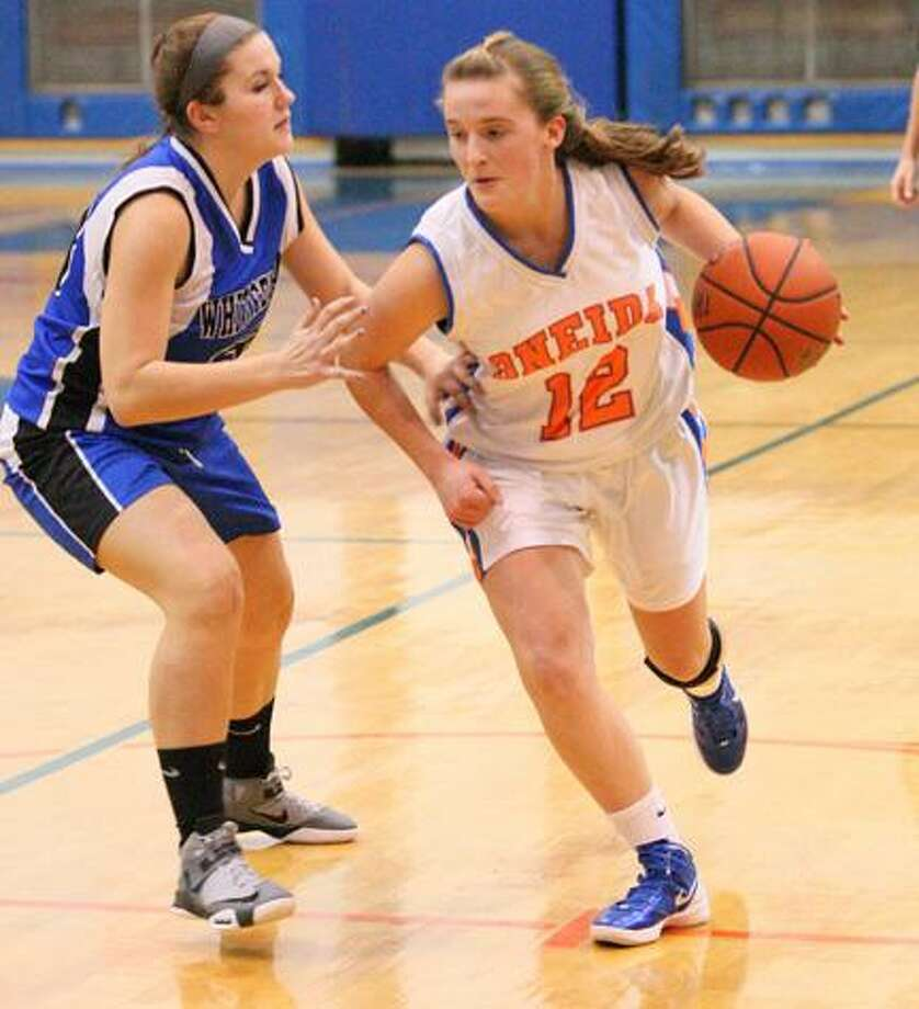 JOHN HAEGER @OneidaPhoto on Twitter/Oneida Daily DispatchOneida's Nichole Shene (12) drives down the court against Whitesboro. Shene was named to the All-TVL second team.